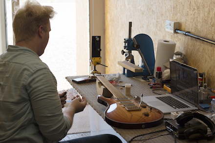 Patrick Lake working on a Guitar in the Cardiff Container